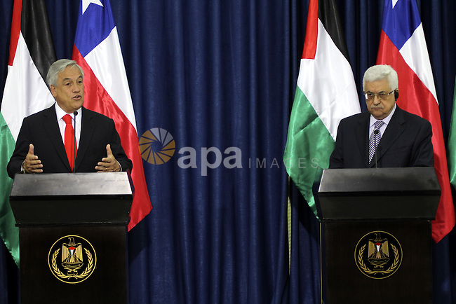 Palestinian President Mahmoud Abbas and the Chile's President Sebastian Pinera attend a press conference in the West Bank town of Ramallah on March 5,2011. In the second day visit of Pinera that will also take him to Bethlehem, where he will meet local officials and visit Aida refugee camp and the Church of Nativity where he will attend a special mass. Chile recognized in January the Palestinian state and upgraded the Palestine mission in Chile to the level of embassy. Photo by Issam Rimawi