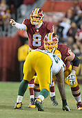 Washington Redskins quarterback Kirk Cousins (8) directs his team's offense against the Green Bay Packers in an NFC Wild Card game at FedEx Field in Landover, Maryland on Sunday, January 10, 2016.  The Packers won the game 35 - 18.<br /> Credit: Ron Sachs / CNP