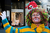 Düsseldorf, Germany. 15 February 2015. A female clown. Street carnival celebrations take place on Königsallee (Kö) in Düsseldorf ahead of the traditional Shrove Monday parade (Rosenmontagszug).