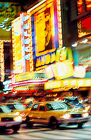 USA, New York, New York City. Times Square illuminated at night with yellow taxis