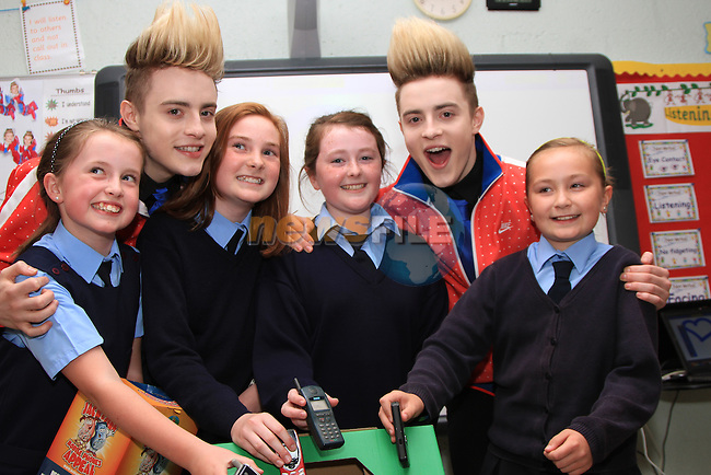Presentation Primary School in Drogheda receive a visit from Jedward as the prize for collecting the most used mobile phones per student for the Jack and Jill Foundation. pictured here with students Jessica Salmon, Aoife Walsh, Caoimhe Bradwell and Ellen Healy...(Photo credit should read Jenny Matthews www.newsfile.ie)....This Picture has been sent you under the conditions enclosed by:.Newsfile Ltd..The Studio,.Millmount Abbey,.Drogheda,.Co Meath..Ireland..Tel: +353(0)41-9871240.Fax: +353(0)41-9871260.GSM: +353(0)86-2500958.email: pictures@newsfile.ie.www.newsfile.ie.Presentation Primary School in Drogheda receive a visit from Jedward as the prize for collecting the most used mobile phones per student for the Jack and Jill Foundation. ..(Photo credit should read Jenny Matthews www.newsfile.ie)....This Picture has been sent you under the conditions enclosed by:.Newsfile Ltd..The Studio,.Millmount Abbey,.Drogheda,.Co Meath..Ireland..Tel: +353(0)41-9871240.Fax: +353(0)41-9871260.GSM: +353(0)86-2500958.email: pictures@newsfile.ie.www.newsfile.ie.