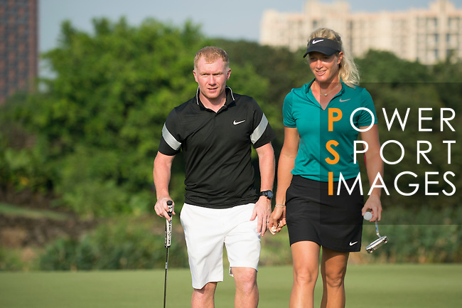 Suzann Pettersen (in green) and Robbie Fowler (in black) shake hands at the end of their game during the World Celebrity Pro-Am 2016 Mission Hills China Golf Tournament on 23 October 2016, in Haikou, Hainan province, China. Photo by Marcio Machado / Power Sport Images