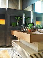 A pair of double basins set in honey toned cast concrete