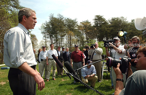 United States President George W. Bush speaks to reporters at the James J. Rowley Training Center in Beltsville, Maryland on April 19, 2002.  The President expressed his sadness at the death of Canadian Soldiers in a friendly fire incident in Afghanistan.<br /> Credit: Ron Sachs / CNP