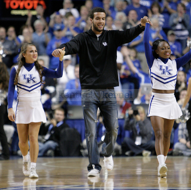 """Matt Roark is brought out to be the """"Y"""" in the game against Portland at Rupp Arena on Saturday, Nov. 26, 2011 after quarterbacking the football team to a victory over Tennessee earlier in the day to break a 26 year losing streak. Photo by Scott Hannigan 