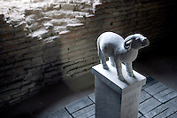"Una statua di pietra raffigurante uno degli animali dello zodiaco cinese, parte della grande installazione ""Pechino 2008: il tempo, gli animali, la storia"", dell'artista cinese Huang Rui, al Museo delle Mura di Porta San Sebastiano, Roma, 8 febbraio 2008..A stone carving representing one of the animals of the Chinese zodiac, part of the large-scale installation ""Beijing 2008: Animal time in Chinese history"" by the Chinese artist Huang Rui, at Rome's Wall Museum of St. Sebastien's Door, 8 february 2008..UPDATE IMAGES PRESS/Riccardo De Luca"