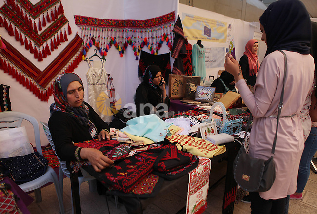 Palestinians take part in the open day at Birzeit University, in the West Bank city of Ramallah on May 9, 2015. Photo by Shadi Hatem