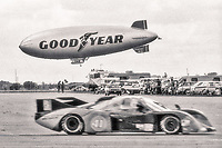 #41 Rondeau M382 001/Chevrolet  of Gary Belcher, John Gunn, and Jean Rondeau, 47th place, races past the Goodyear Blimp, 12 Hours of Sebring, IMSA Camel GT race, Sebring International Raceway, Sebring, Florida, March 24, 1984.  (Photo by Brian Cleary/www.bcpix.com)