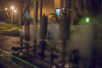 Crowds of visitors and Pratt Institute students and faculty welcome in the New Year, Tuesday, January 1, 2013 at the school's steam generating plant in Brooklyn in New York. Pratt Institute is the home of the oldest steam generators in the country which are used to heat the campus and run the school's co-generating plant. The power plant is a Mechanical Engineering Landmark. As unique as the plant is, what is more unique is that every New Year's Eve, the Chief Engineer Conrad Milster connects his collection of steam whistles, including the whistle from the USS Normandy and a steam calliope and sets them all off enveloping the crowd in a fog of steam and very LOUD noise. (© Richard B. Levine)