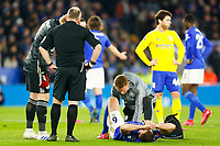 4th March 2020; King Power Stadium, Leicester, Midlands, England; English FA Cup Football, Leicester City versus Birmingham City; Jonny Evans of Leicester City lies on the ground as a physio attends to his injury