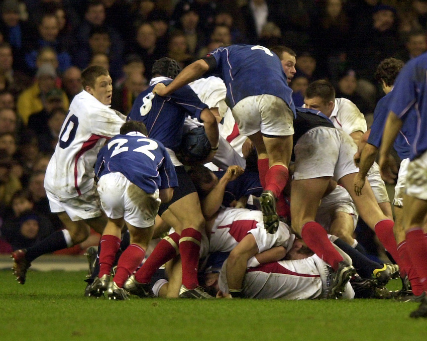 Photo. Richard Lane. .England v France at Twickenham. RBS Six Nations Championship. 15/02/2003.Olivier Brouzet rucks Lawrence Dallaglio