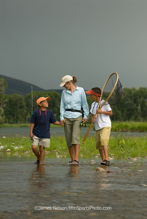 A mother walks with her 8- and 10-year-old sons to fly fish on a trout run on the South Fork of the Snake River, Idaho.