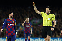 7th March 2020; Camp Nou, Barcelona, Catalonia, Spain; La Liga Football, Barcelona versus Real Sociedad;  Leo Messi is shown a yellow card by the referee
