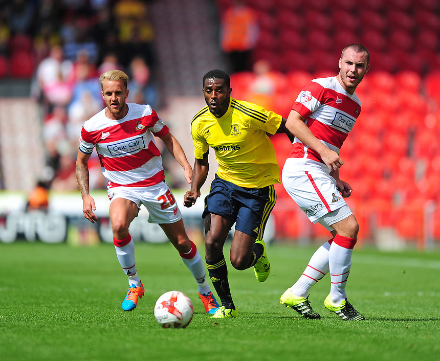 Middlesbrough's Mustapha Carayol vies for possession with Doncaster Rovers' James Coppinger, left, and Doncaster Rovers' Luke McCullough<br /> <br /> Photographer Chris Vaughan/CameraSport<br /> <br /> Football - Pre-Season Friendly - Doncaster Rovers v Middlesbrough - Saturday 25th July 2015 - Keepmoat Stadium, Doncaster<br /> <br /> &copy; CameraSport - 43 Linden Ave. Countesthorpe. Leicester. England. LE8 5PG - Tel: +44 (0) 116 277 4147 - admin@camerasport.com - www.camerasport.com