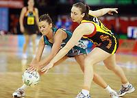 11.07.2010 Magic's Jade Clarke and Thunderbirds Emily Beaton in action during the ANZ Champs Final netball match between the Magic and Tunderbirds played at the Adelaide Entertainment Centre in Adelaide. ©MBPHOTO/Michael Bradley