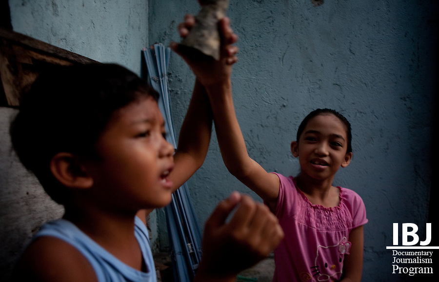 Two children playing outside in Manila.