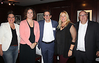 NWA Democrat-Gazette/CARIN SCHOPPMEYER Jenn Cozens (from left), Laura and Kyle Kellams and Corinna and Alan Dranow help support the Literacy Council of Benton County at Read Between the Wines on Sept. 13 at River Grille Steakhouse in Bentonville.