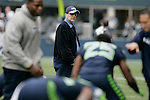 Seattle Seahawks team owner Paul Allen ,center, walks across the field as the team warms up before their game with the Minnesota Vikings at CenturyLink Field in Seattle, Washington on November 4, 2012.    ©2012. Jim Bryant Photo. All Rights Reserved.