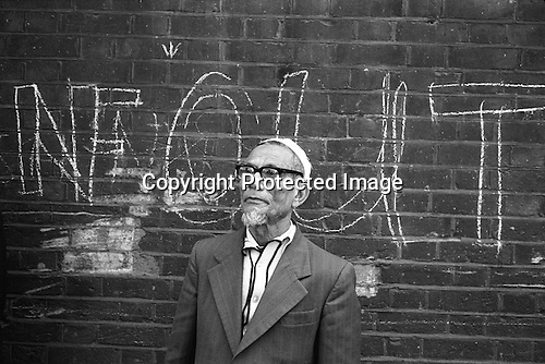 Brick Lane Asian community 1970s Tower hamlets. East London UK NF OUT refers to the national Front who were trying to garner support for their anti immigration policies. <br /> <br /> My ref 26/3568/,1978,