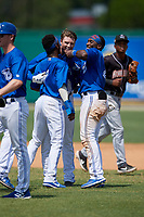 Dunedin Blue Jays Kacy Clemens (21) celebrates with Samad Taylor (1) and Chavez Young (2) after hitting a game winning single to score Ryan Noda (not shown) during a Florida State League game against the Jupiter Hammerheads on May 16, 2019 at Jack Russell Memorial Stadium in Clearwater, Florida.  Dunedin defeated Jupiter 1-0.  (Mike Janes/Four Seam Images)