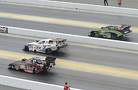 Apr. 15, 2012; Concord, NC, USA: NHRA funny car drivers (from right) Alexis DeJoria , Mike Neff and Blake Alexander race during eliminations for the Four Wide Nationals at zMax Dragway. Mandatory Credit: Mark J. Rebilas-