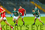 East Kerry's Tommy Bowler is tackled by Ben Hanafin  St Brendans in the County Minor football final in Austin Stack Park on Wednesday evening