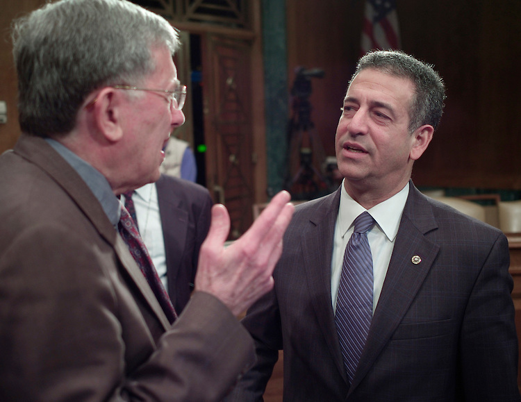 "01/30/07--Sen. Russ Feingold, D-Wis., talks with witness Louis Fisher, left, a constitutional law expert with the Library of Congress after chairing a Senate Judiciary hearing titled ""Exercising Congress' Constitutional Power to End a War."" Other witnesses were: David J. Barron, a professor at Harvard Law School; Bradford Berenson, Sidley Austin partner; Walter Dellinger, a professor at Duke University School of law and former acting U.S. solicitor general;; and Robert F. Turner, associate director of the Center for National Security Law at the University of Virginia School of Law..Congressional Quarterly Photo by Scott J. Ferrell"