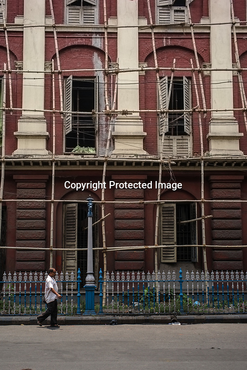 A pedestrian walks past the Writers Building, the secretariat building of the State Government of West Bengal in BBD Bagh in Kolkata, West Bengal  on Friday, May 26, 2017. Photographer: Sanjit Das