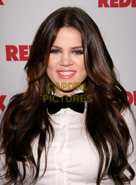 KHLOE KARDASHIAN ODOM.at REDBOOK's first-ever family issue celebration held at The Sunset Tower Hotel in West Hollywood, California, USA, April 11th 2011..portrait headshot smiling beauty  black white shirt  bow tie                                                        .CAP/RKE/DVS.©DVS/RockinExposures/Capital Pictures.