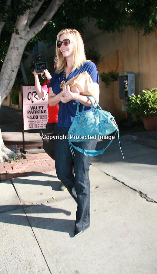 AbilityFilms@yahoo.com 805-427-3519.www.AbilityFilms.com .1-14-08 Natasha henstridge spotted leaving Orso in restaurant in hollywood