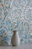 Climbing Vine, a handmade mosaic shown Quartz and Aquamarine jewel glass, is part of the Silk Road Collection by Sara Baldwin for New Ravenna.<br />