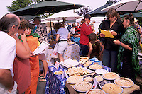 Artisan Baker selling Baked Pies at the Saturday Market in Ganges, on Saltspring Island, in the Southern Gulf Islands of British Columbia, Canada