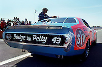 BROOKLYN, MI - JUNE 19: Richard Petty's STP Dodge sits in the pit lane before a 1977 NASCAR race at Michigan International Speedway near Brooklyn, Michigan.
