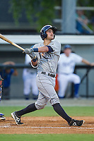 Nick Ciuffo (14) of the Princeton Rays follows through on his swing against the Burlington Royals at Burlington Athletic Park on July 11, 2014 in Burlington, North Carolina.  The Rays defeated the Royals 5-3.  (Brian Westerholt/Four Seam Images)