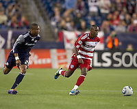 FC Dallas midfielder Jackson Goncalves (6) dribbles as New England Revolution defender Darrius Barnes (25) closes. In a Major League Soccer (MLS) match, the New England Revolution defeated FC Dallas, 2-0, at Gillette Stadium on September 10, 2011.
