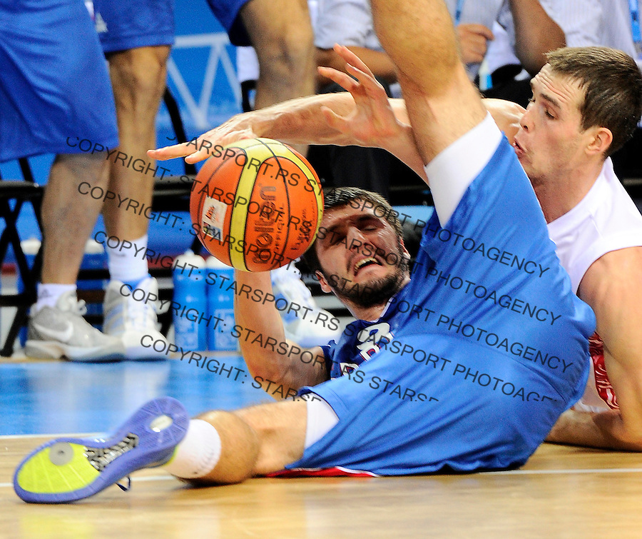 Stefan Markovic, Bykov Sergey, during quarterfinal basketball game between Russia and Serbia in Kaunas, Lithuania, Eurobasket 2011, Thursday, September 15, 2011. (photo: Pedja Milosavljevic)
