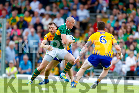Kieran Donaghy Kerry in action against Cillian Brennan Clare during the Munster GAA Football Senior Championship semi-final match between Kerry and Clare at Fitzgerald Stadium in Killarney on Sunday.