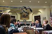 Flanked by Ron Klain, Ebola Response Coordinator, and Lisa Monaco, Homeland Security Advisor to President Obama,  United States President Barack Obama speaks to the media during a meeting with his national security and public health teams concerning the government's Ebola response, in the Roosevelt Room of the White House, on November 18, 2014, in Washington, DC. President Obama called on Congress to approve $6.2 billion in emergency spending to fight Ebola in West Africa.<br /> Credit: Drew Angerer / Pool via CNP