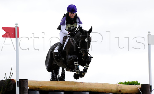 2009 Mitsubishi Motors Badminton Horse Trials.Baminton UK.The Cross country phase:.Heidi Woodhead (GBR) riding The Biz.Clears the Wadworths Barrels fence.The 3 day event was won by Oliver Townend (GBR) riding Flint Curtis..
