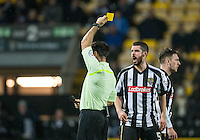 Richard Duffy of Notts Co shows his frustration at being handed a yellow card during the Sky Bet League 2 match between Notts County and Wycombe Wanderers at Meadow Lane, Nottingham, England on 10 December 2016. Photo by Andy Rowland.