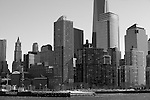 """""""Skyscrapers"""" Black and White Downtown Manhattan New York. I shot this Downtown Manhattan Skyline scene while on a boat tour in the days before the worst storm in 20 years blew in lasting three days. The strong winds made it difficult to stay warm, hold my camera stable on my monopod and stay out of the water spray from the waves created by the boat. The New World Trade Center tower was just finishing construction at the top and rises high above the other skyscrapers. During the storm Governors in surrounding states and New York banned driving personal vehicles on the public highways for a couple days.  Being from Lake Tahoe I came prepared for the weather and was excited to capture New York City and Central Park with fresh snow. The incredible skyline of Manhattan was breathtaking. Growing up in California, visiting San Francisco as an adult regularly and shooting it many times as a professional photographer didn't prepare me for the magnitude of the impressive size and quantity of the buildings and skyscrapers that form the skyline of Manhattan. My hat is off to the Architects and Engineers who contributed to building the touted greatest city on Earth. Black and white photography is still my favorite so you will see many images offered in Color and BW."""