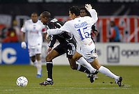 DC United forward Jamil Walker (23) makes a run while being pursued by CD Olimpia defender Nahun Avila Amaya (15). DC United defeated CD Olimpia 3-2 to advance to the semi finals of the CONCACAF Champions' Cup. March 1, 2007 at RFK Stadium in Washington DC.