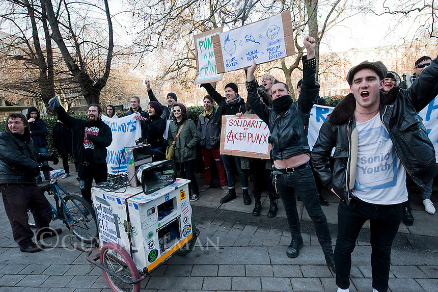 Punks protest outside the Indonesian Embassy in London. 20-12-11 Punks protest outside the Indonesian Embassy in London following the arrest of 64 punks in Aceh Indonesia who have been detained for 'reschooling' which includes having their heads shaved. They were joined by Johnny 'Itch' Fox lead singer of the King Blues and a very load sound system playing clash songs.