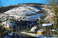 The wine village Tokaj at the confluence of the Bodrog and Tiza river. Behind the village, vineyards covered in snow on the steep slopes. The small village called Tokaj is where the two rivers Bodrog and Tisza joins. It is much visited by tourists. the centre has been beautifully restored.