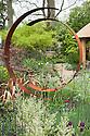 The M&G Centenary Garden – 'Windows through Time' - a celebration of 100 years of Chelsea garden design, designed by Roger Platts, Gold medal winner, RHS Chelsea Flower Show 2013.