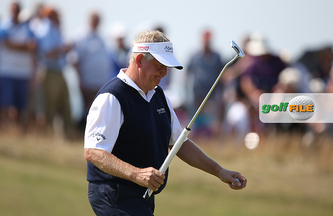 Colin Montgomerie (SCO) battles to hold par during Round One of the 2014 Senior Open Championship presented by Rolex from Royal Porthcawl Golf Club, Porthcawl, Wales. Picture:  David Lloyd / www.golffile.ie