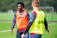 Wilfried Bony ( left) looks on during the Swansea City training session at The Fairwood training Ground, Swansea, Wales, UK. Wednesday 13 September 2017