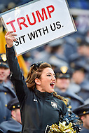 Baltimore, MD - DEC 10, 2016: Army cheerleader gets the crowd pumped with a Trump sign before the game between Army and Navy at M&T Bank Stadium, Baltimore, MD. (Photo by Phil Peters/Media Images International)