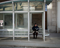 Cold day waiting in the bus shelter.