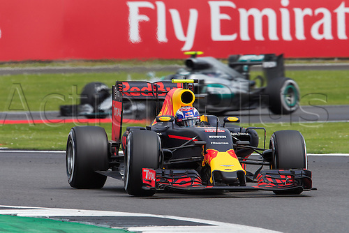 10.07.2016. Silverstone, England. Formula One British Grand Prix, race day.  Red Bull Racing driver Max Verstappen ahead of Mercedes AMG Petronas Formula One Team driver Nico Rosberg as the race winds down